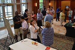 Pharmaceutical Analysis Conference attendees at a reception.