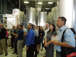 Participants at August Land O' Lakes tour the Wisconsin Brewing Company